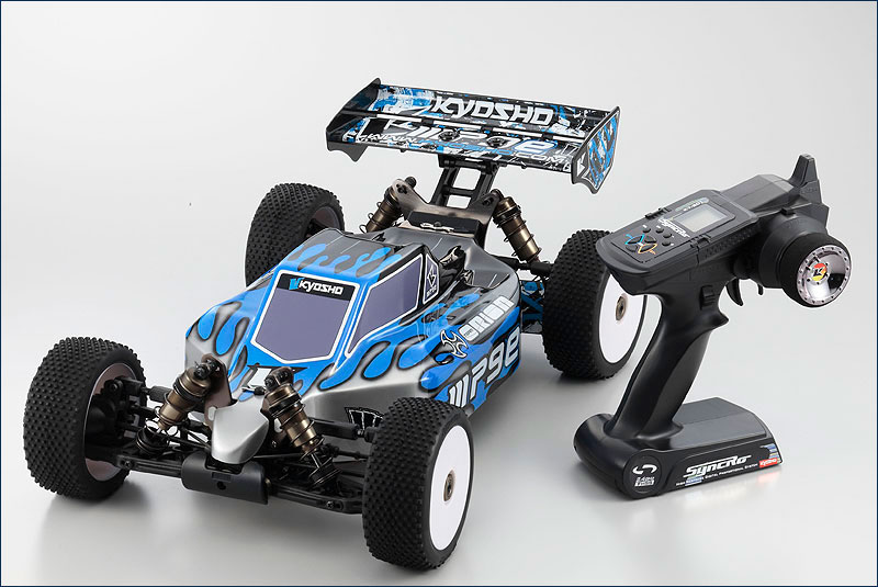 ������ ���������� ����� Kyosho Inferno MP9e TKI 1 (������� / ��������������� ������� / ���������� 2.4 GHz / ������� ��������)